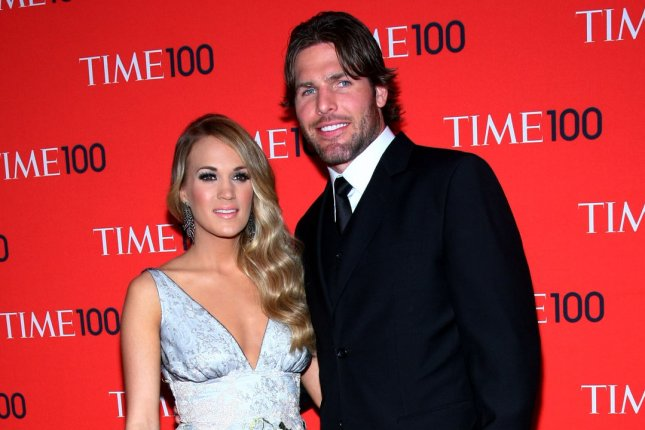 Carrie Underwood and Mike Fisher arrive on the red carpet at the TIME 100 Gala at Jazz at Lincoln Center on April 29, 2014 in New York City. UPI/Monika Graff