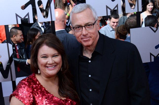 Dr. Drew Pinsky (R) and Dr. Annette Ermshar at the MTV Movie Awards on April 13, 2014. Dr. Drew On Call was canceled this week. File Photo by Jim Ruymen/UPI