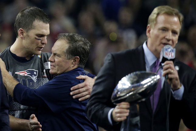 New England Patriots coach Bill Belichick and Tom Brady embrace while NFL  Commissioner Roger Goodell speaks holding the Vince Lombardi trophy after  the ... 71cd6df85