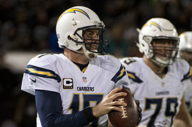 San Diego Chargers quarterback Phillip Rivers (17) and OL Kenny Wiggins. Photo by Terry Schmitt/UPI