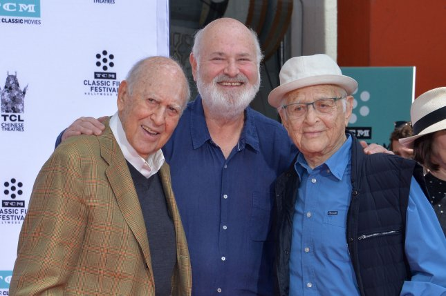 Actors and directors Carl Reiner (L) and Rob Reiner (C) are joined by producer and writer Norman Lear during a father and son double hand and footprint ceremony immortalizing them in the forecourt of TCL Chinese Theatre in Los Angeles on April 7. File Photo by Jim Ruymen/UPI
