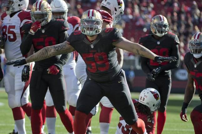 Former San Francisco 49ers defensive lineman Aaron Lynch (59) celebrates after stopping Arizona Cardinals running back Chris Johnson (23) in the first quarter on November 29, 2015 at Levi's Stadium in Santa Clara, California. File photo by Terry Schmitt/UPI