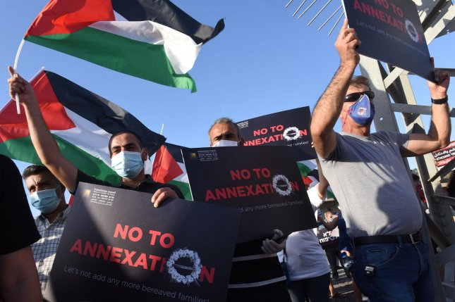 Palestinians and Israelis protest against Israel's plan to annex parts of the West Bank at the Almog Junction near Jericho in the West Bank on Saturday.  Photo by Debbie Hill/UPI