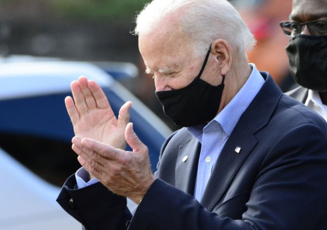 Democratic presidential candidate Joe Biden applauds supporters outside the Greensburg Depot, one of his stops on the Build Back Better train tour through Ohio and Pennsylvania in Greensburg, Pa., on September 30. Photo by Archie Carpenter/UPI