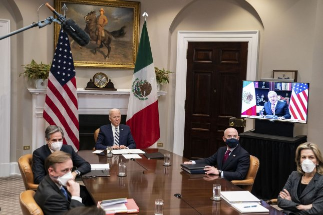 President Joe Biden participates in a virtual bilateral meeting with President Andrés Manuel López Obrador of Mexico in the Roosevelt Room of the White House. Pool photo by Anna Moneymaker/UPI