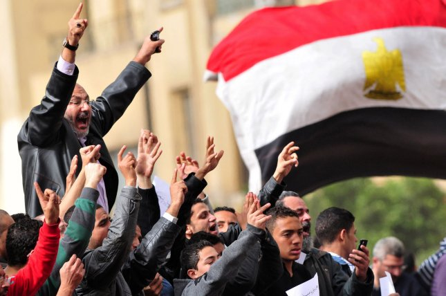 Egyptian demonstrators protest in Cairo's main square. The Supreme Council of Armed Forces has declared the planned September elections will be delayed until at least October. UPI