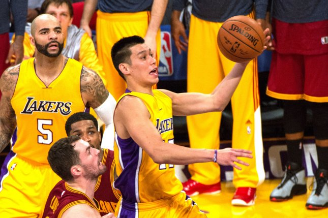 Los Angeles Lakers guard Jeremy Lin scores against Cleveland Cavalier Kevin  Love (L) and LeBron James during the second half of their NBA game at  Staples ... b31e715c3