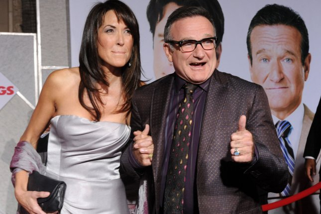 Robin Williams attending the premiere of Old Dogs with his wife Susan Schneider on November 9, 2009. The actor's final role in the film Absolutely Anything before his death in 2014 is heading to U.S. theaters. File Photo by Jim Ruymen/UPI