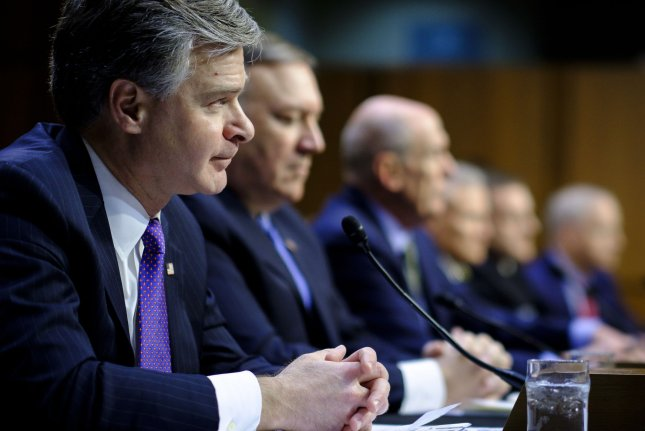 FBI Director Christopher Wray testifies before the Senate Select Intelligence Committee during a hearing about worldwide threats on Tuesday in Washington, D.C. Photo by Pete Marovich/UPI