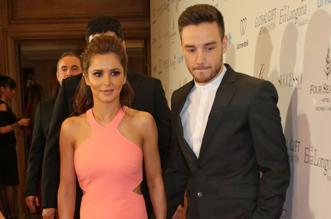 Liam Payne (R), pictured with Cheryl Cole, addressed his relationship with the singer in a new interview. File Photo by David Silpa/UPI