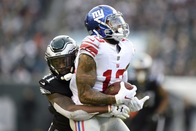 New York Giants wide receiver Odell Beckham Jr. (13) is tackled by Philadelphia Eagles cornerback DeVante Bausby (41) during the second half on November 25, 2018 at Lincoln Financial Field in Philadelphia. Photo by Derik Hamilton/UPI