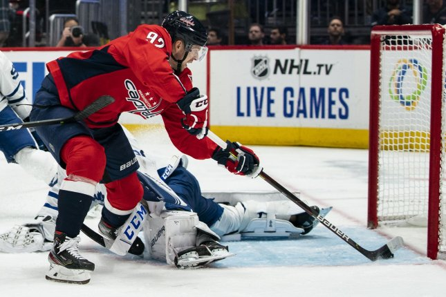 Washington Capitals center Evgeny Kuznetsov scores the game-tying goal in the second period of a win against the Toronto Maples Leafs on Wednesday in Washington, D.C. Photo by Alex Edelman/UPI