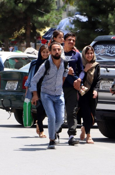 People rush to their homes after Taliban fighters entered Kabul, Afghanistan, on Sunday. Photo by Bashir Darwish/UPI
