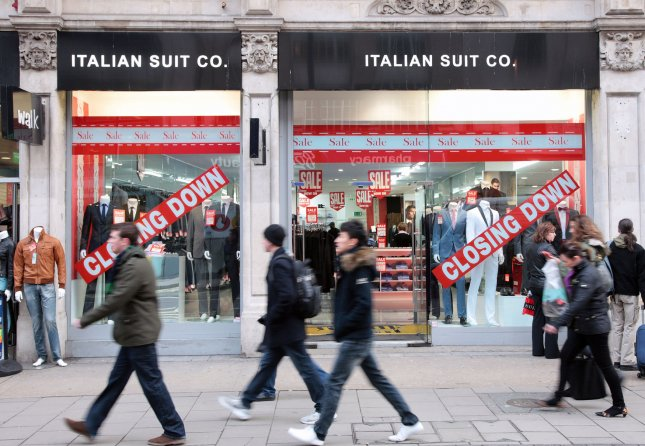British teens unhappy due to family conflict, bullying, body image. Shoppers walk past sale signs in retail store windows on London's Oxford street. UPI/Hugo Philpott