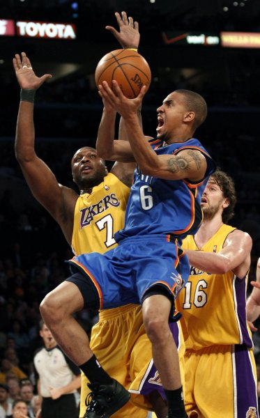 Los Angeles Lakers forward Lamar Odom (7) tries to stop Oklahoma City Thunder guard Eric Maynor (6) during the first half of Game 2 of their Western Conference playoff series at Staples Center in Los Angeles on April 20, 2010. The Lakers defeated the Thunder 95-92. UPI Photo/Lori Shepler