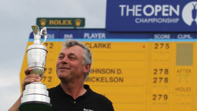 Darren Clarke, shown after winning the 2011 British Open, was grouped with Ernie Els and Zach Johnson for the first two rounds of this year's British Open, which begins Thursday. UPI/Hugo Philpott