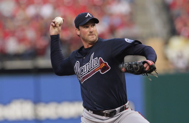 Derek Lowe, shown in a 2011 game when he was a member of the Atlanta Braves, was signed by the New York Yankees Monday and placed on the 25-man active roster. UPI/Bill Greenblatt