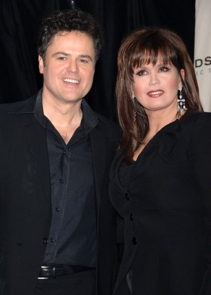 Marie Osmond (R) and her brother Donny Osmond appear backstage during a taping of the fourth annual TV Land Awards show on March 19, 2006 in Santa Monica, California. The Osmonds were honored with the favorite singing siblings award at the awards show which honors classic television performers and their shows and will be telecast on the TV Land cable channel on March 22. (UPI Photo/Jim Ruymen)