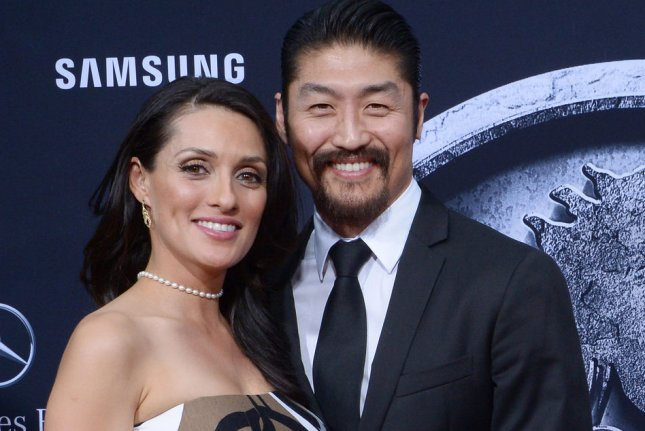 Brian Tee (R) and his wife Mirelly Taylor attending the premiere of Jurassic World on June 9, 2015. Tee revealed on social media Sunday that he is set to star as the villainous Shredder in Teenage Mutant Ninja Turtles 2 and gave fans their first look at the character's new costume. File Photo by Jim Ruymen/UPI