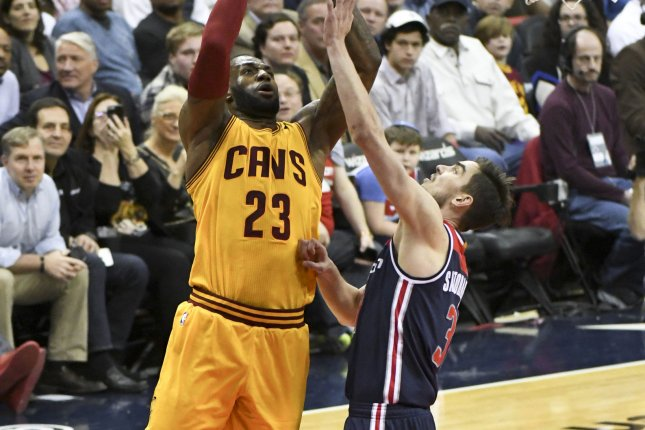3756823d32c6 Cleveland Cavaliers forward LeBron James (23) scores against Washington  Wizards guard Tomas Satoransky (31) in the first half at the Verizon Center  in ...