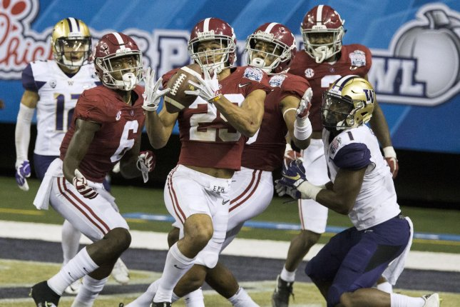 Alabama defensive back Minkah Fitzpatrick (29) intercepts a pass in the end zone intended for Washington wide receiver John Ross, right, in the closing seconds of the second half of the 2016 Peach Bowl at the Georgia Dome in Atlanta, Georgia on December 31, 2016. File photo by Mark Wallheiser/UPI