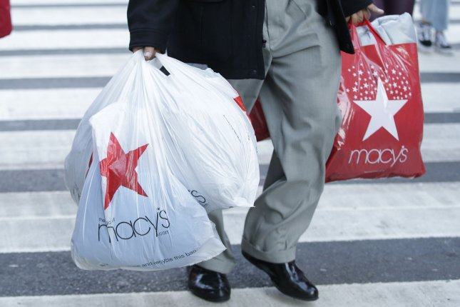 U.S. consumer sentiment hit a 14-year high this month, according to a University of Michigan survey Friday. File Photo by John Angelillo/UPI