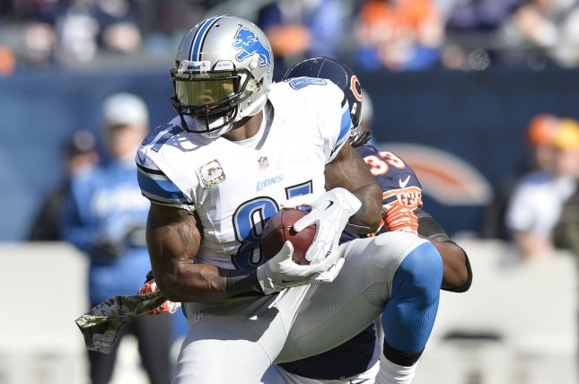 Former Detroit Lions wide receiver Calvin Johnson (81) catches a 15-yard pass as ex-Chicago Bears cornerback Charles Tillman (33) defends during the first quarter on November 10, 2013 at Soldier Field in Chicago. File photo by Brian Kersey/UPI
