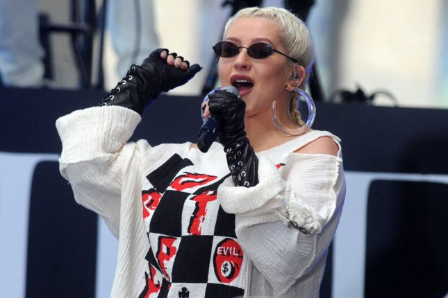 Christina Aguilera postponed a stop on her Liberation tour due to illness. File Photo by Dennis Van Tine/UPI