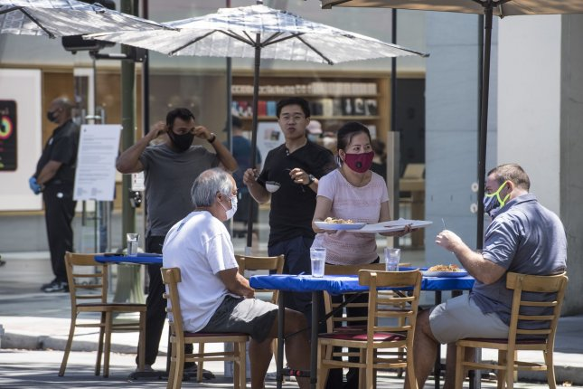 Patrons dine at outside tables in Palo Alto, California in July as COVID-19 cases were peaking in the United States. File Photo by Terry Schmitt/UPI