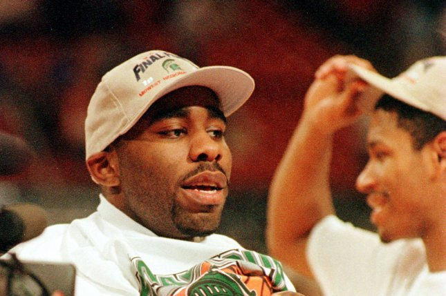 Michigan State's Mateen Cleaves slips on a Final Four t-shirt, after his Spartans' upset The University of Kentucky Wildcats',73-66, in the NCAA Midwest Regional Final game, March 21, 1999. File photo Burton Haun/UPI