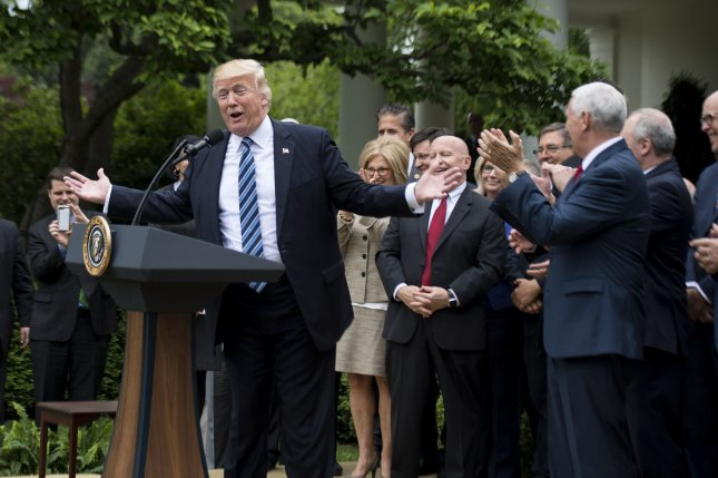 President Donald Trump, joined by Republican House leadership and members, speaks during a White House celebration of the House's narrow passage of the retooled American Health Care Act on Thursday. Photo by Kevin Dietsch/UPI