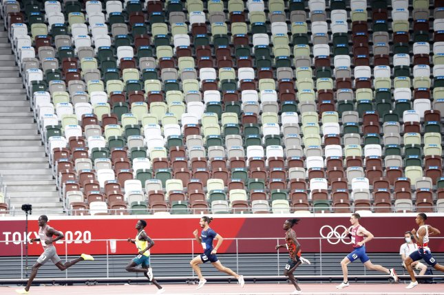 Athletes run in a men's 800-meter semifinal in front of empty seats at Olympic Stadium during the 2020 Summer Olympics in Tokyo on Sunday. The stadium's capacity is 60,102 but attendance was limited to athletes, media, volunteers, officials and dignateries. Photo by Tasos Katopodis/UPI