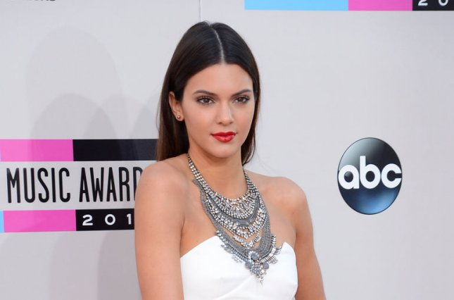 Model/TV personalities Kendall Jenner arrives for the 41st annual American Music Awards held at Nokia Theatre L.A. Live in Los Angeles on November 24, 2013. UPI/Phil McCarten