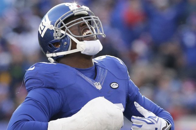 New York Giants Jason Pierre-Paul reacts after sacking Carolina Panthers Cam Newton for a 9 yard loss in the second quarter at MetLife Stadium in East Rutherford, New Jersey on December 20, 2015. The Panthers defeated the Giants 38-35 and remain undefeated at 14-0. Photo by John Angelillo/UPI