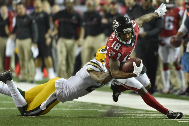Atlanta Falcons wide receiver Taylor Gabriel (18) runs for 8-yards as Green Bay Packers free safety Ha Ha Clinton-Dix (21) makes the tackle during the second half of the NFC Championship game on January 22 at the Georgia Dome in Atlanta, Ga. File photo by David Tulis/UPI