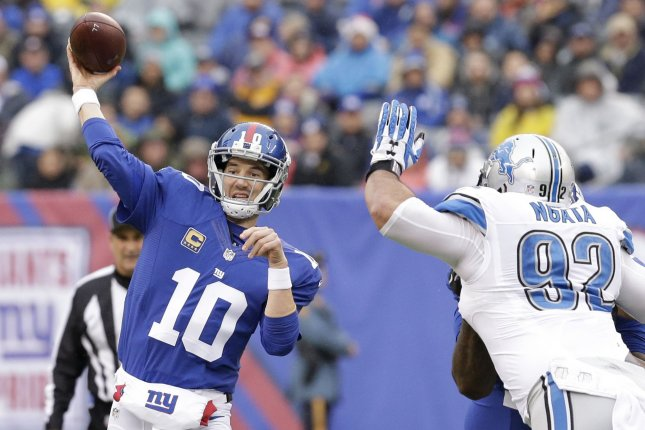 Detroit Lions Haloti Ngata raises his hands as New York Giants Eli Manning throws a pass in week 15 of the NFL at MetLife Stadium in East Rutherford, New Jersey on December 18, 2016. File photo by John Angelillo/UPI