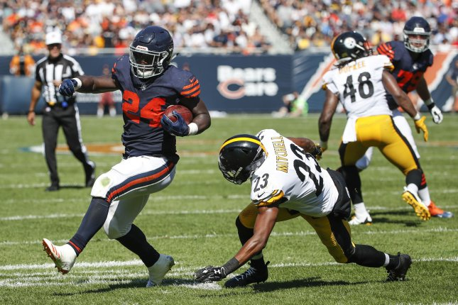Chicago Bears running back Jordan Howard (24) is defended by Pittsburgh Steelers free safety Mike Mitchell (23) during the first half on September 24, 2017 at Soldier Field in Chicago. Photo by Kamil Krzaczynski/UPI