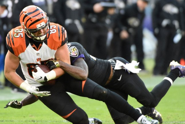 Baltimore Ravens safety Lardarius Webb (R) tackles Cincinnati Bengals tight end Tyler Eifert (85) after a 13-yard gain during the second half of their NFL game at M&T Bank Stadium in Baltimore, Md. File photo by David Tulis/UPI