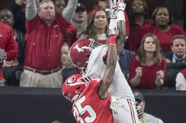 Former Georgia Bulldogs defensive back Aaron Davis (35) breaks up a pass in the end zone intended for Alabama Crimson Tide wide receiver Jerry Jeudy (4) in the fourth quarter of the NCAA College Football Playoff National Championship on January 8 at Mercedes-Benz Stadium in Atlanta. Photo by Mark Wallheiser/UPI