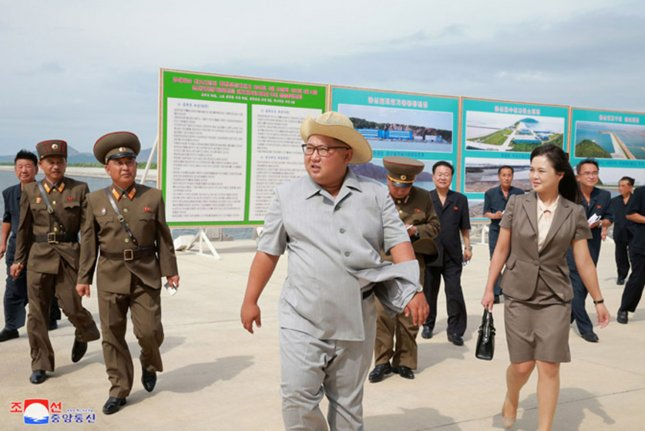 Kim Jong Un (C) was the target of an assassination attempt in the Wonsan-Kalma region of North Korea, a former Japanese military official says. File Photo by KCNA/UPI