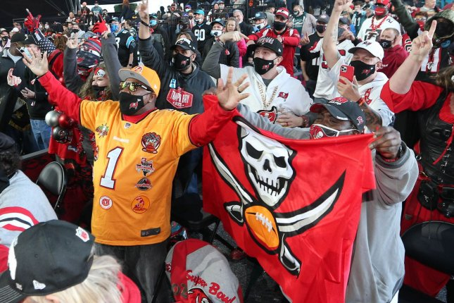 Tampa Bay Buccaneers fans cheer during the second round of the 2021 NFL Draft on Friday in Cleveland. Photo by Aaron Josefczyk/UPI