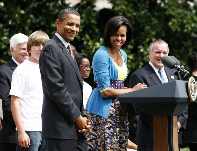 U.S. President Barack Obama (L) and Chicago Mayor Richard Daley (R) listen to First Lady Michelle Obama (C) as she speaks at an event promoting Chicago's bid for the 2016 Summer Olympics and Paralympics on the South Lawn of the White House in Washington on September 16, 2009. UPI/Aude Guerrucci/Pool