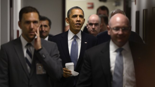 US President Barack Obama walks to a breifing to delivers remarks on the Government Shutdown at FEMA's National Responce Coordination Center in Washington, D.C. on October 7, 2013. UPI/Shawn Thew/Pool