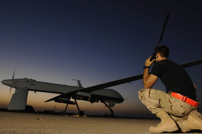 U.S. Air Force Airman 1st Class Justin Cole communicates with the pilot of an MQ-1 Predator unmanned aerial vehicle prior to a night mission from Ali Air Base, Iraq on November 5, 2007. The Predators operate on 24-hour operations in support of Operation Iraqi Freedom. UPI/Jonathan Snyder/U.S. Air Force