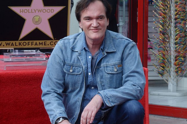 Quentin Tarantino at an unveiling ceremony honoring him with the 2,569th star on the Hollywood Walk of Fame on December 21. The director is facing copyright infringement accusations in court as a set of writers filed a lawsuit asking for hundreds of millions of dollars in damages. Photo by Jim Ruymen/UPI