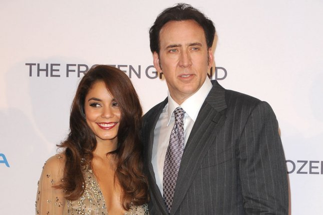 American actress Vanessa Hudgens and American actor Nicolas Cage attend the premiere of Frozen Ground in London on July 17, 2013. File Photo by Paul Treadway/UPI