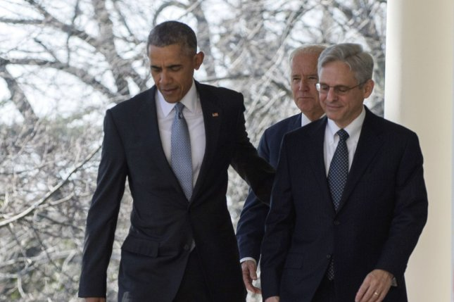President Barack Obama walks along the West Colonnade of the White House with former Supreme Court nominee Merrick Garland on March 16, 2016. Garland, who was chosen by the president to replace the late Antonin Scalia on the high court bench, was ultimately unsuccessful in his bid for the Supreme Court as his nomination formally expired on Tuesday with the adjournment of the 114th Congress. File Photo by Pat Benic/UPI