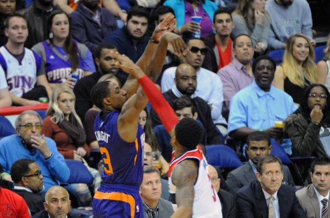Phoenix Suns guard Brandon Knight (3) scores a three-point basket against Washington Wizards guard Bradley Beal (3) in the first half at the Verizon Center in Washington, D.C. on December 4, 2015. File photo by Mark Goldman/UPI