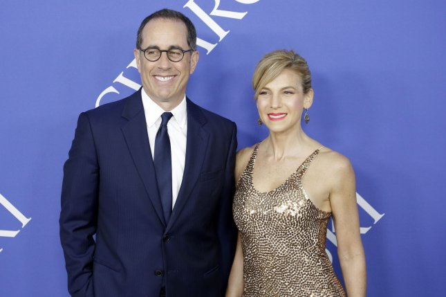 Jerry Seinfeld (L), seen here with wife Jessica Seinfeld, teased the return of his Netflix talk show Comedians in Cars Getting Coffee by sharing brief clips of his humorous exchanges with some of his guests from the upcoming Season 11. File Photo by John Angelillo/UPI