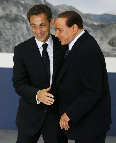 Italian Prime Minister Silvio Berlusconi (L) greets French President Nicolas Sarkozy as he arrives for a round table session at the G8 summit in L'Aquila, Italy on July 8, 2009. (UPI Photo/Stringer)
